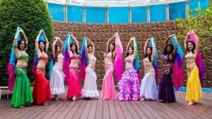 belly dancers both hands up pose